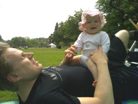 Baby playing with daddy in the park