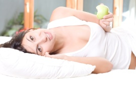 Woman relaxing eating apple