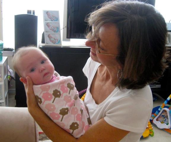 Doula Pam Diamond with a swaddled newborn