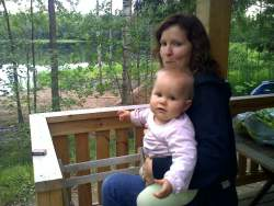 Ten months old baby at summer cabin lake Finland