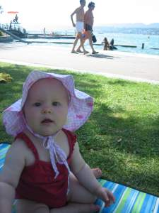 Ten months old baby playing at Zurich lake