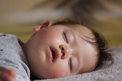 Seemingly exhausted baby sleeping
