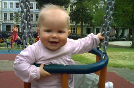 Eight months old baby playing in the park