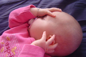 Baby sleeping in pink close up
