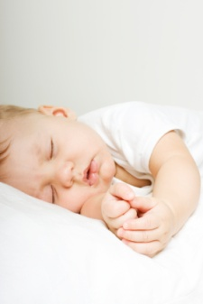 Beautiful baby sleeping folding hands